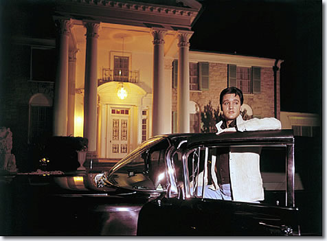 Elvis Presley posed with one of his cars outside Graceland in this photograph published March 7, 1965.